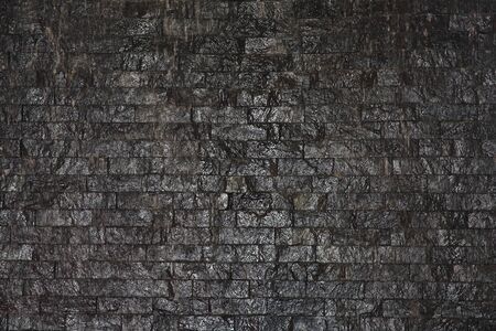 black brick wall photo