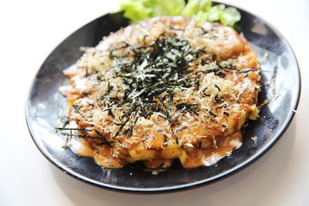 Japanese food okonomiyaki , Japanese pizza Reklamní fotografie