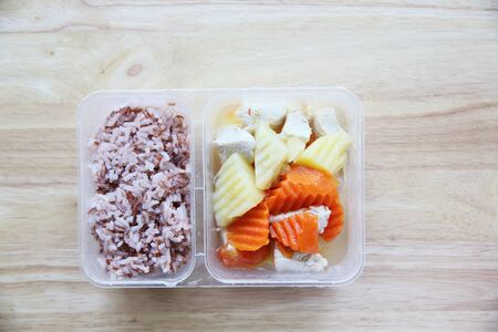 bento: Clean food steam potato chicken carrot with rice in bento Stock Photo