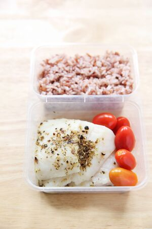 bento: Clean food Fish steak with rice in bento Stock Photo
