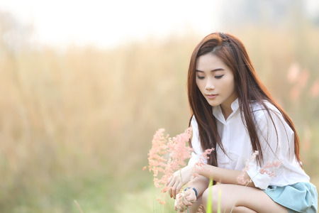 Asian girl on wheat field Stock Photo