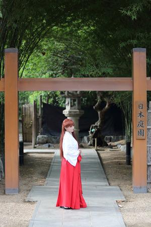 priestess: Asian girl portrait, Japanese Miko in nature Stock Photo