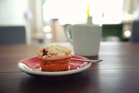 blueberry muffin: Blueberry muffin with hot tea on wood background Stock Photo