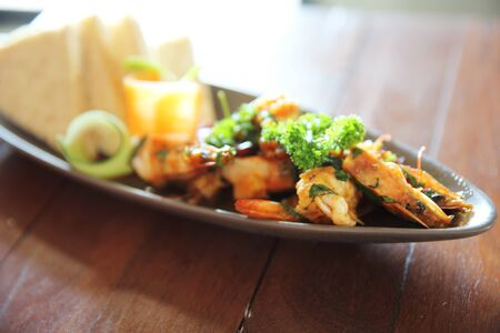 sizzling: sizzling chilli shrimps with bread Stock Photo