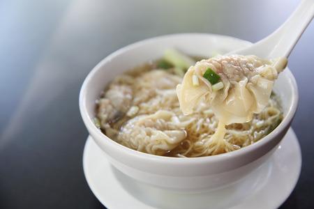 noodles soup: noodle and dumpling in close up