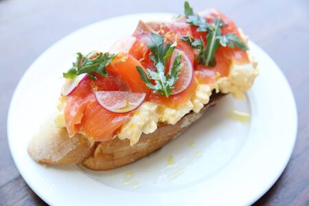 wheat toast: Scrambled eggs with smoked salmon and whole wheat toast