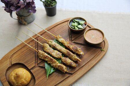 chicken satay: Chicken Satay on wood