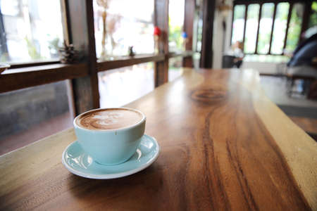 acidity: A cup of cappuccino coffee