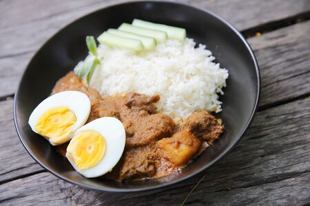 japanese cookery: Curry rice on wood background