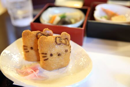 beancurd: Japanese sushi Inari sushi, fried bean-curd stuffed with boiled rice kitty cat