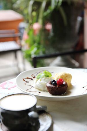 Chocolate lava cake and berries with ice cream Stock Photo