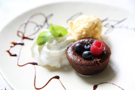 Chocolate lava cake and berries with ice cream Stock Photo