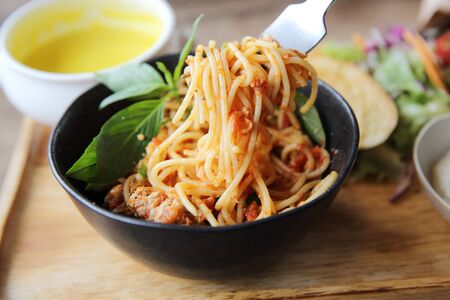 marinara sauce: spaghetti and meatballs on wood background italian food