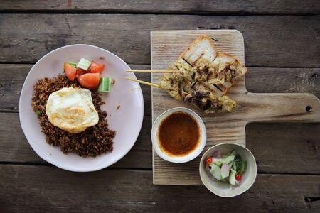 malaysian food: Malaysian food chicken satay with peanut sauce on wood background