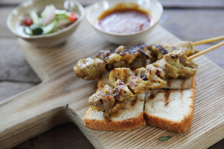 chicken satay: Malaysian food chicken satay with peanut sauce on wood background