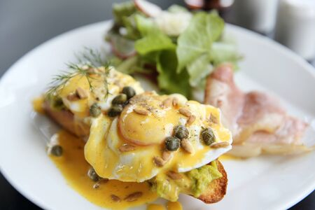 uk cuisine: Eggs Benedict toasted English muffins,bacon, poached eggs Stock Photo