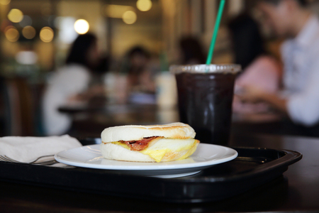 bap: Bacon and fried egg roll with coffee