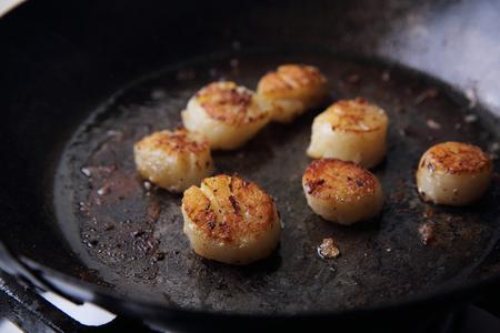 Scallops fried in pan Stock Photo