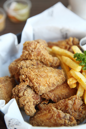 Fried chicken on wood background