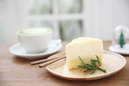 cheesecake japanese style with green tea on wood background Stock Photo