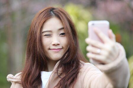 Asian Woman Selfie With Cherry Blossom Sakura Stock Photo