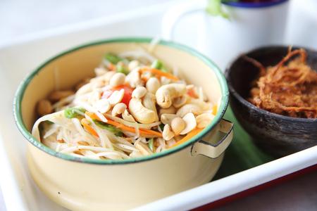 Local Thai food somtum with pork amd sticky rice Stock Photo