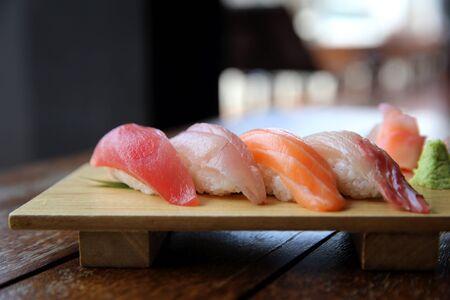 Mix sushi tuna salmon sea bass sushi on wood background japanese food Stock Photo