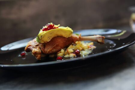 duck confit in black tone food Stock Photo