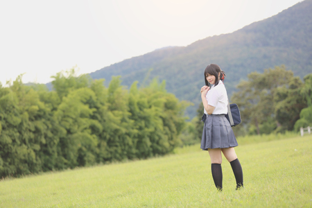 Japanese school in countryside with grass mountain and tree  Stock Photo