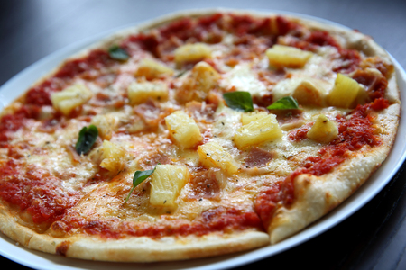 Hawaiian pizza , Pizza with ham pineapple cheese on wood background
