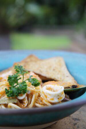 Spaghetti seafood with bread