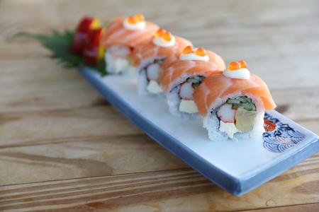 Sushi rolls with salmon on top , Japanese cuisine Stock Photo