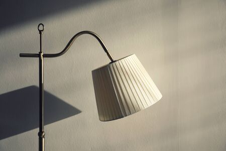 Lamp on wall background Stock Photo
