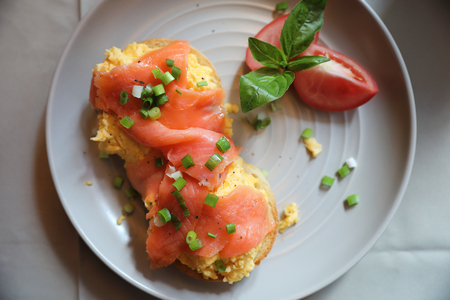 Scrambled eggs with smoked salmon on toast , Breakfast food Stock fotó