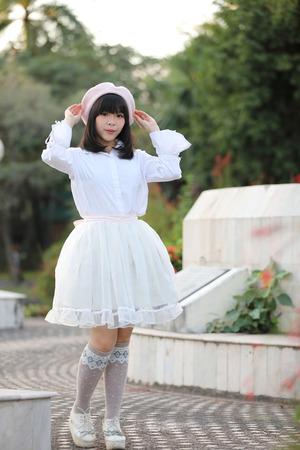 portrait asian woman lolita dress on nature park