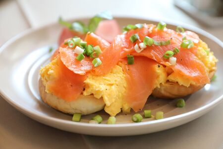 Scrambled eggs with smoked salmon on toast , Breakfast food 스톡 콘텐츠