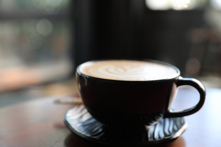 Cappuccino coffee break on wood background