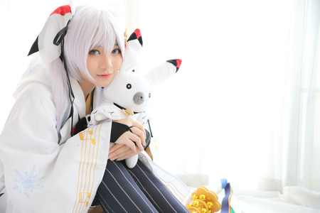 Japan anime cosplay , white japanese miko in white tone room