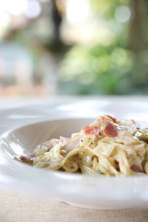 Spaghetti carbonara white sauce with bacon and cheese