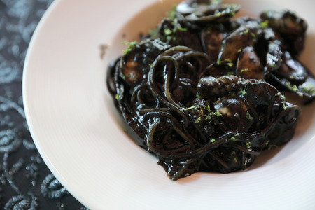 Spaghetti seafood with squid ink , Italian food Stock Photo
