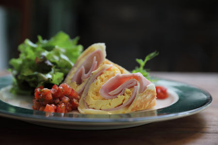 Breakfast burrito ham and eggs with salad vintage style