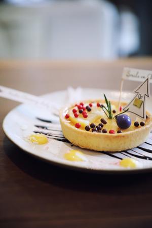 Lemon tart pie topping with chocolate ball sweet dessert on wood background