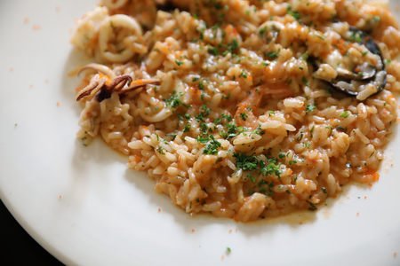 Seafood Risotto , traditional italian rice on table