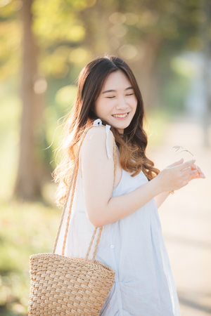Portrait of Young Asian woman girl smile in flower garden Stock Photo - 124616221