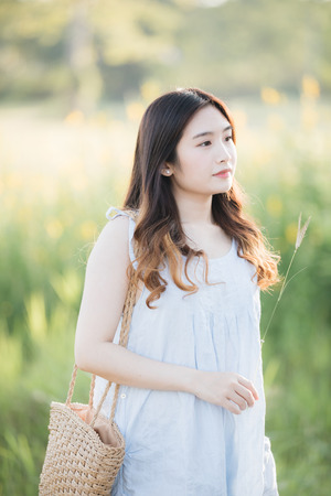 Portrait of Young Asian woman girl smile in flower garden Stock Photo - 124619122