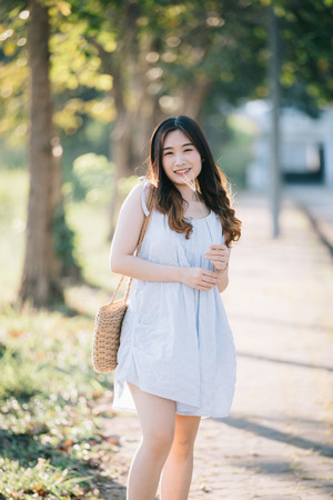 Portrait of Young Asian woman girl smile in flower garden Stock Photo - 124619135