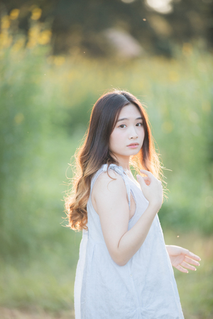 Portrait of Young Asian woman girl smile in flower garden Stock Photo - 124619140