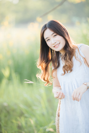 Portrait of Young Asian woman girl smile in flower garden