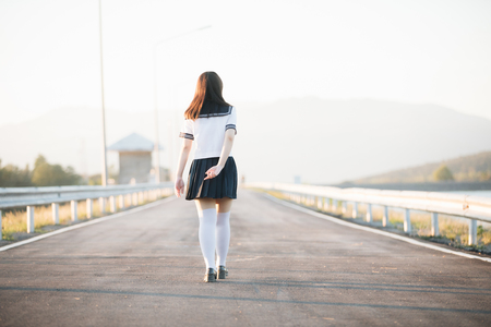 Portrait of Japanese school girl uniform smile with walkway and river