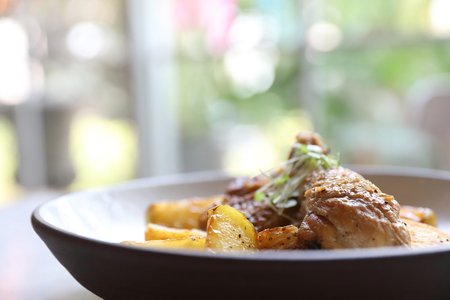 Braised roasted chicken with potatoes Imagens